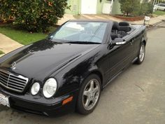 The fastest car I've ever owned.  2002 Black Mercedes AMG CLK 55 Cabriolet.