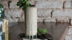 The Thin Mint by Justin Fairweather, Evelyn Drinkery, New York How to make it: Procure 1oz London dry gin, 3/4oz creme de menthe, 1oz creme de cacao, 2 scoops of vanilla bean ice cream, a handful of mint leaves, and 4 cookies. Put them all in a blender, pulse them until they're almost smooth, then pour directly into your mouth a 16oz pint glass.
