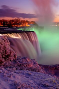 A winter view of the American Falls and Goat Island at sunset