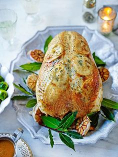 Roast Turkey ~ insert lemon slices under the skin. Stuff with pieces of lemon, lime & tangerine, halved shallots, & fresh herbs. Open a couple of bags of a citrus tea & spread on the bottom of the roasting pan (if you have a rack). Totally fresh twist on turkey and house will smell amazing!