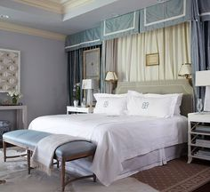 A lavish fabric treatment draped across one wall extends the royal treatment of a bed canopy to the entire luxurious bedroom./