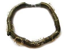 Terhi Tolvanen - Pistille d'or 2008. Necklace ø 19 cm. Wood, laquer, silver, gold.