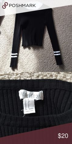 Crop long sleeve shirt Tight fitting crop women's black long sleeve shirt with white stripes at the wrists. Supper comfortable!!!!! And soft!!! Only worn a couple of times and in perfect condition! Forever 21 Tops Crop Tops