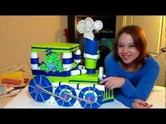 "This is a fun DIY instructional How-to Video. Have everyone at the baby shower going goo-goo ga-ga over the choo choo train! Inspired by a special request from ""Melanie"" I gave this my best shot. Make your own version today! Its a creative creation! chuga chuga choo choo :)"