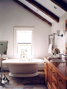 Rustic Country Bath A pedestal-base soaking tub takes center stage in this gracious master bath. wood vanity enhance the natural look of the room. Country Baths, Wood Vanity, Wood Beams, Dream Bathrooms, Better Homes And Gardens, Country Decor, Country Style, My Dream Home, Decoration