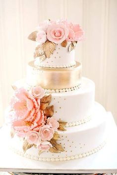 Roses decorate an elegant white and metallic gold wedding cake - I love the gold dots on the white cake, such a nice touch ~ http://www.modwedding.com/galleries/wedding-cakes-desserts/