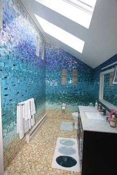 Beautiful tile job for a beachy bathroom!