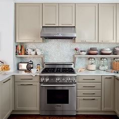 Classic beige tan kitchen with chevron tiled splashback.