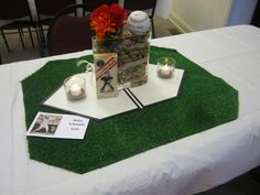 Centerpiece including bride and groom signatures on the baseball