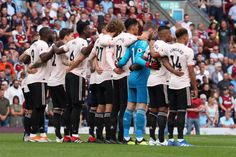 Manchester United players during a minutes silence after Jimmy Mcilroy passed away during the Premier League match between Burnley FC and Manchester United at Turf Moor on September 2018 in. Burnley Fc, Manchester United Players, Premier League Matches, Passed Away, Broncos, The Unit, Sports, Hs Sports, Sport