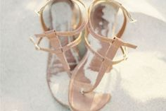 """Saying """"I do"""" in the sand? Behold some major beach wedding inspiration with these metallic, bow-tied, and bedazzled sandals!"""