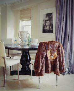 fur coat and luxurious curtains
