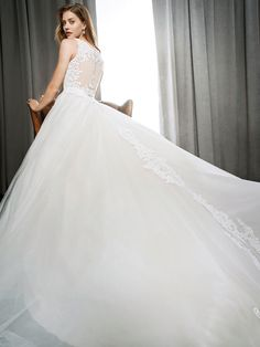 Kenneth Winston Style 1695 | soft and romantic wedding dress with embroidery lace accents and illusion back | luxurious bridal gown