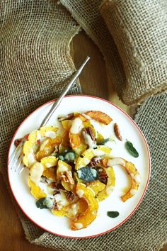 Delicata squash are great because they don't have to be peeled, and have great flavor - and sage is a winner to pair with winter squash.  This looks amazing:  Roasted Delicata Squash with Miso Dressing :: Set the Table