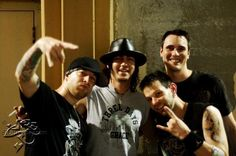 Three of the members of Breaking Benjamin with Adam Gontier of Three Days Grace