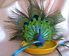 I love Peacocks. And this idea. Peacock Wedding  Peacock Feather Ring Bearer Dish by All4Brides, $40.00
