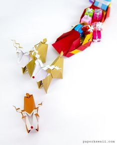 Origami Reindeer Tutorial - Make a cute paper Rudolf!, Learn how to fold an origami reindeer! This cute origami reindeer is made from a single sheet of paper, no glue or cutting, add a red nose to make a Rudolf. He makes an adorable Christmas decoration! Cute Origami, Origami Star Box, Origami Ball, Origami Fish, Useful Origami, Paper Crafts Origami, Origami Stars, Diy Origami, Origami Tutorial