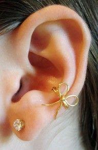 Bow Clip Earring (no piercings needed)    http://www.google.com/url?sa=t&rct;=j&q;=bow%20earring%20cuff&source;=web&cd;=1&ved;=0CEkQFjAA&url;=http%3A%2F%2Fwww.etsy.com%2Flisting%2F67159601%2Fgolden-beau-bow-ear-cuff&ei;=lacPT6jGA8ndggfq79jhAw&usg;=AFQjCNFlUtospHvcbmnpvaJVcqKg6y7WZg