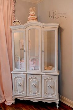 China Cabinet refinished. Glass replaced with mirrors for sweet Ava's Nursery!