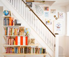 staircase bookshelves...Think I'd put the shleves inside the wall since it's unused space anyway.  Love the idea (;
