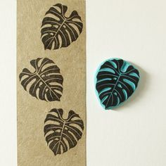 This is a rubber stamp of a tropical leaf for your summer ideas. Perfect for projects with a tropical touch. Stamp it in cards, tags, invitations, tea towels, fabric, pin cushions, notebooks and much more!  ❋ Sizes of stamps: 1.5 x 1 1/8 or 2 x 1.6  ❋ Care: For frequent use just wipe down with moist baby tissue.  ❋ Rubber stamp made to order  ❋ It comes either unmounted, mounted on wood or mounted with a storage box made of cardboard.  You might also like this other rubber stamp of a palm…