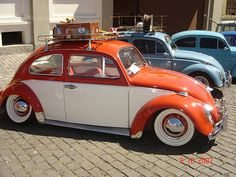 1963 VW Beetle  Orange and White I do so very much want a nifty car like this when I can drive.