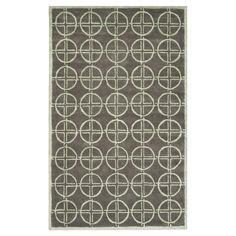Hand-tufted New Zealand wool rug in brown and gold with a circles motif.  Product: RugConstruction Material: New...