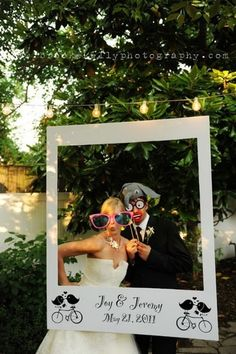 """Just when we thought wedding photo booth props were getting a little stale, we spotted this clever Polaroid inspired idea. Cute! Plus, it's such a simple DIY project. Anyone can do this."" - from..."