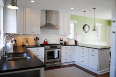 These kitchen remodelers achieved 21st century convenience while honoring the traditional style of their 1930's era home. | thisoldhouse.com