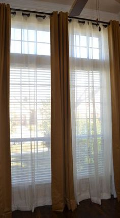 Lori ~ this is the idea of what I meant last night with the Purple sheers behind the white curtains.  Cozy's it up, you can get the tie-backs that hold just the curtain or in my room when I want windows open I put both into the tie-back rods on either side of window!!