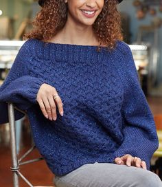 Free Knitting Pattern for 8 Row Repeat Cable Sweater - Dramatic oversized long sleeved pullover with wide ribbed boat neck and overall cable pattern with just 2 rows of cable and 6 of stockinette in the repeat. Sizes XS, Small, Medium, Large, X-Large, XX-Large, and XXX-Large. Designed by Merri Fromm for Red Heart.