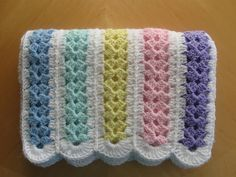 Free pattern for a crocheted baby blanket. You may make this pattern any length or width you wish, simply by adding rows and strips. For an adult size, 17 strips and 100 rows becomes a very nice afghan. Be sure to purchase extra yarn if you intend to enlarge this pattern. http://web.archive.org/web/20070624143119/http:/www.caron.com/projects/cs/pro_cs_milemin.html