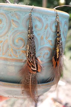 Gypsy Sun Filigree Brass and Feather Earrings. $22.00, via Etsy.