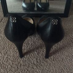 Black Coach Pumps Size 9. Black. Heel 4.5 inches  from top to bottom.  Gently used but in good shape. Fit true to size. I do not have the box. Coach Shoes Heels