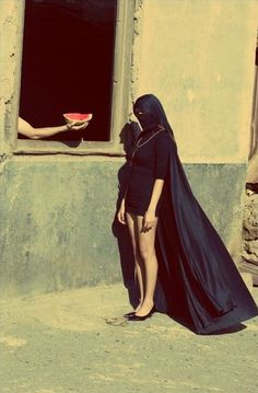 WHAT???is she a Ninja or something and why is that arm giving her watermelon???