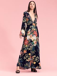Garden Life Maxi Dress | Beautiful maxi dress featured in a big and colorful floral print.    * Plunging V-neckline   * Open slit in back with a button closure   * Long sleeves   * Flared cuff pieced with eyelash lace   * Hidden back zip closure
