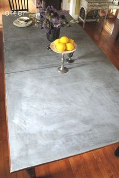 """Zinc Top Table    Basic Steps: Cut sheets of zinc and affixed them to the table with industrial adhesive. Hammer repeatedly and use copper solution to age. It's an easy way to get a new """"French bistro"""" look that gets better with age. It also adds a different metal look/texture when your room is full of wood."""