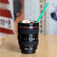 For Cam. Looks like a camera lens, but it's a coffee cup.