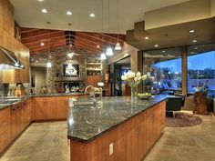 Modern Kitchen with Exposed beam, Black Marinace Granite Countertop, Kitchen island, Concrete floors, Simple Granite, Flush