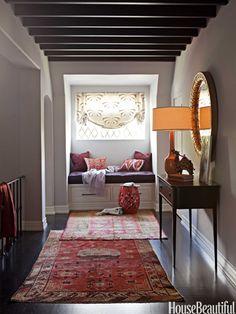 layered rugs....Vintage Turkish runners. Design: Betsy Burnham. Photo: Amy Neunsinger. housebeautiful.com. #hallway #vintage #turkish_runners #carpets #garden_stool