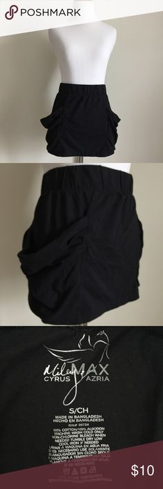 Max Azria Black Mini Skirt w/ Pockets Max Azria for Miley Cyrus Black Mini Skirt. Size S. Great for Girl's Night Out. 2 functional ruffle size pockets. Elastic stretch waistband. 100% Cotton. Gently worn. Smoke-free home. No rips, holes, or stains. Max Azria Skirts Mini