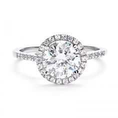 LOVE THIS!  Center Round Diamond with White Gold Halo Setting