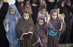 Gaza Strip: Palestinian girls pray in Gaza City