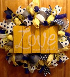 A personal favorite from my Etsy shop https://www.etsy.com/listing/487488738/deco-mesh-wreath-yellow-and-blue-with
