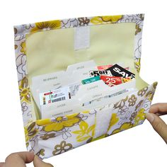 Purse size coupon holder has attractive flower design and makes organizing money saving coupons a breeze. Features a hook and loop handle that attaches to shopping cart so coupons are easily accessibl