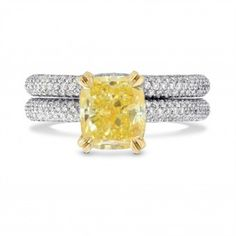 3.24Ct TWFancy intense yellow cushion diamond engagement and wedding ring bridal set, mounted in Platinum and 18K yellow gold. The engagement ring is set with a 2.47Ct fancy intense yellow cushion diamond certified by GIA, with yellow gold double prongs. The shank of the engagement ring and the wedding band are styled with collection color round brilliants weighing a total of 0.77Ct TW, in a closed pave round profile setting. The wedding ring fits adjacent to the engagement ring. For more…