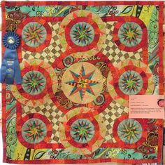 Carnivale, 39 x 39, by Jan Soules.  First place winner, small pieced quilt. Photo by Quilt Inspiration.