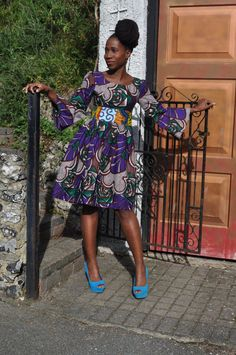 Vibrant African print purple short dress with contrast print band on the wast, deep hidden pockets and flared sleeves. on Etsy, $111.11