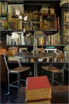books, artwork, rustic reading table