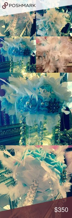 """Brooch bouquet """"great Gatsby"""" inspired Beautiful handmade brooch bouquet adorned with light turquoise real touch flowers , brooches, cascading white feathers , pearls, crystal chandelier strands, white silk ribbon, white tulle with rhinestones and pearls trim the handle. 3 large white pearls fish the handle   This is a elegant and statement bouquet. Large size. Accessories"""